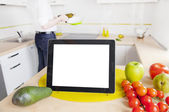Tablet computer with blank screen in the kitchen — Stock Photo