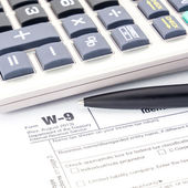 Tax form W-9 and pen — Stock Photo