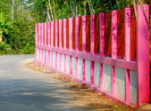 Pink painted on fence — Stockfoto