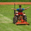 Man on mower cutting grass — Stock Photo #37472199