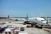 An aircraft parking at Changi airport — Photo