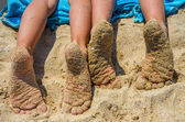 Children's feet in sand — Stock Photo