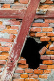 Hole in a red brick wall — Stock Photo