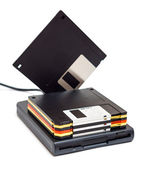 External usb floppy disk drive with disks one standing — Stockfoto