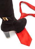Shoe steps on a necktie — Stock Photo