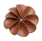 Chocolate nut chips in shape of flower — Stock Photo
