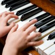 Child hands playing piano — Stock Photo #44848059