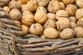 Walnuts in wicker basket — Stock Photo