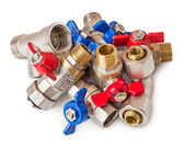 Pile of water valves — Stockfoto