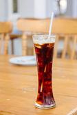 Espresso Ice cube on wood table — Stock Photo