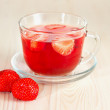 Herbal tea with strawberries — Stock Photo