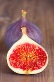 Figs on wooden background — Stock Photo