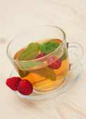 Herbal tea with mint and berry — Stock Photo