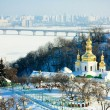 Kiev-Pechersk monastery and frozen river Dnipro — Stock Photo