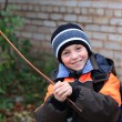 Stock Photo: Boy playing with stick