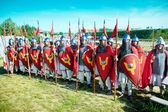 Troop of medieval knights in full armor — Stock Photo
