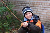 Boy playing with a stick — Stock Photo