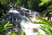Climbing Dunn's river falls in Jamaica — Stock Photo
