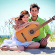 Love couple with a guitar — Stock Photo