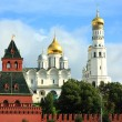 Golden domes of Kremlin and the red kremlin wall — Stock Photo