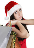 Christmas Girl with Shopping Bags Pouting — Стоковое фото