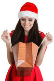 Christmas Girl Looking in Shopping Bag — Стоковое фото