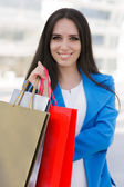 Girl with Shopping Bags Smiling — Stok fotoğraf
