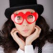 Girl with Heart-Shaped Glasses and Top Hat — Stock Photo
