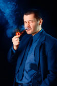 Man with Gun Holstered Smoking Pipe — Stock Photo