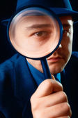Man Looking through Magnifying Glass — Stock Photo