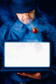 Man with Hat and Pipe Holding Laptop with White Screen — Stock Photo