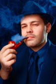 Man with Hat Smoking a Pipe Close Up — Stock Photo