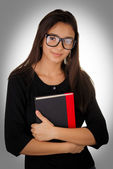 Girl With Glasses Holding a Book — Stock Photo