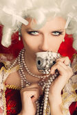 Beautiful Baroque Woman Portrait Drinking from a Cup — Stock Photo