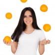 Girl Juggling Oranges White T-shirt and Background — Stock Photo #46365159