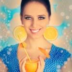 Girl with Orange Drink and Orange Slice Earrings — Stock Photo #46365179