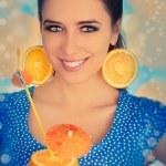 Girl with Orange Drink and Orange Slice Earrings — Stock Photo #46365181