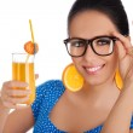 Smart Girl with Orange Juice and Orange Slice Earrings White Background — Stock Photo #46365209