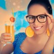 Smart Girl with Orange Juice and Orange Slice Earrings — Stock Photo #46365211