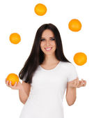 Girl Juggling Oranges White T-shirt and Background — Stock Photo