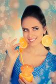 Girl with Orange Drink and Orange Slice Earrings — Foto Stock