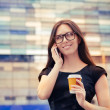 Young Woman with Coffee Cup on the Phone Out in the City — Stockfoto #49871309