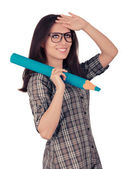 Girl with Glasses Holding Giant Cyan Pencil — Stock Photo