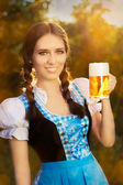 Young Bavarian Woman Holding Beer Tankard — Stockfoto