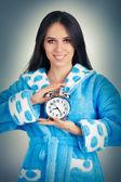 Young Woman in Bathrobe Holding an Alarm Clock — Stock Photo