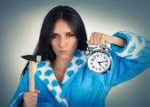 Young Woman Holding a Hammer and an Alarm Clock — Stock Photo