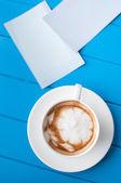 Photos and coffee — Stock Photo