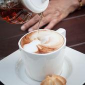 Hot coffee and honey — Stock Photo