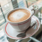 Coffee on a glass table — Stockfoto