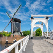 Stock Photo: Bridge and windmill in Netherlands